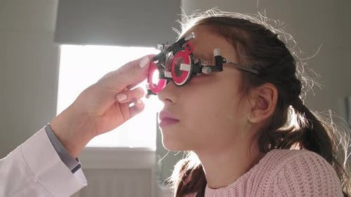 Little Girl Wearing Trial Frame Testing Vision