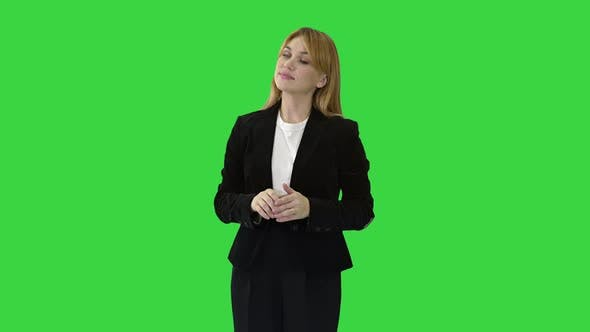 Thumbnail for Young Business Woman Presenting Something Pointing at Virtual Objects To Her Sides on a Green Screen