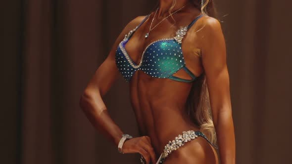 Thumbnail for Tanned Fitness Model Demonstrating Perfect Fit Body, Enduring Self-Improvement