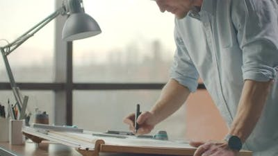 Architect's Desk Drawings Tape Measure Ruler and Other Drawing Tools