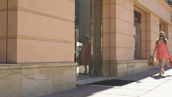 Thumbnail for Female Shopaholic Walking Street With Bags, Consumerism, Gifts Purchase, Sale