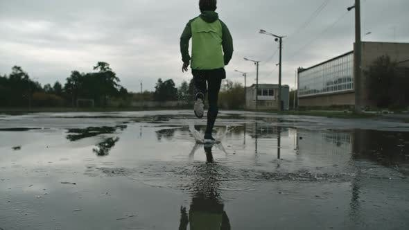 Thumbnail for Strong Man Running Through Puddle