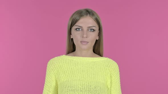 Thumbnail for Beautiful Young Girl Finger on Lips, Pink Background
