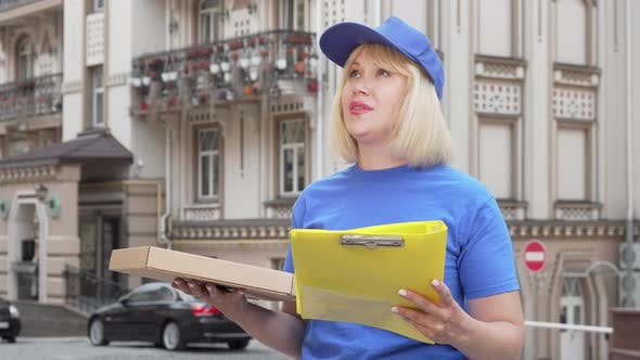 Thumbnail for Friendly Pizza Delivery Woman Smiling To the Camera While Working in the City