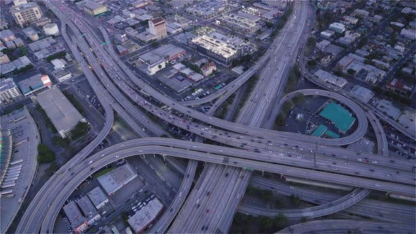 Thumbnail for Birds eye view of The Highway 10 and 110 at dusk as seen from a helicopter