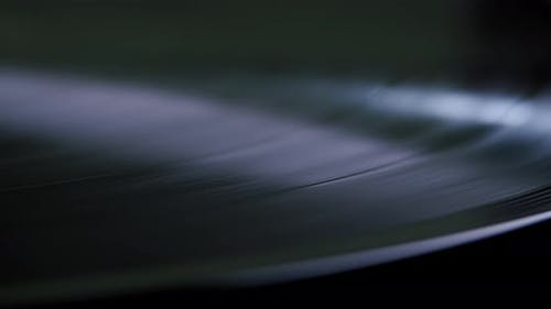 Close Up View of Vinyl Record Player Turntable with Its Stylus Running Along Music Plate