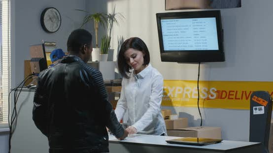 Customer Receiving Package at a Customer Service Desk
