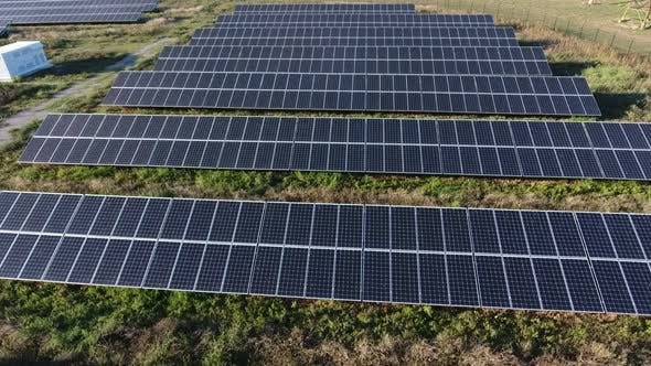 Thumbnail for Aerial Shot of a Solar Power Station From a Low Flying Drone at Splendid Sunset