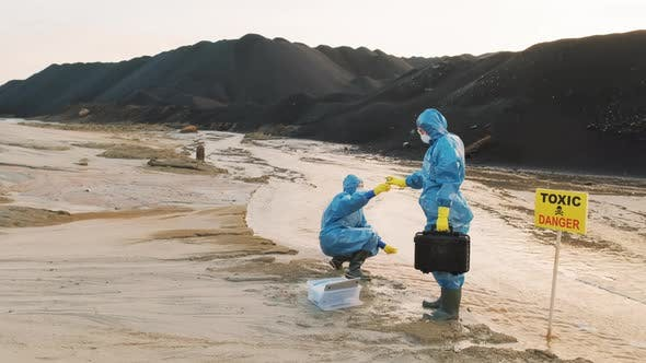 Ecologists In Contaminated Landscape