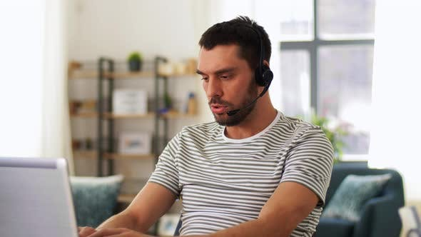 Thumbnail for Man with Headset and Laptop Working at Home