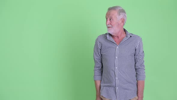 Thumbnail for Happy Senior Bearded Man Touching Something