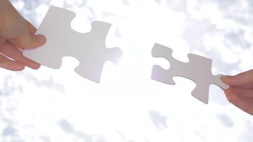 Psychology of Relationships. Logic, Interconnection, Teamwork. Puzzle Pieces Connected. Hand