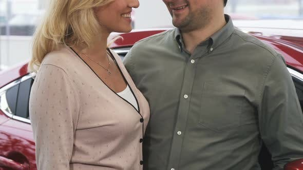 Cropepd Shot of a Happy Couple Holding Car Keys To a Newly Bought Car