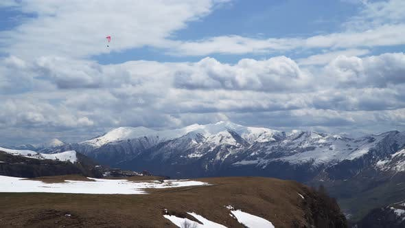 Thumbnail for Caucasus mountains. Paraglider flies among the snow-capped mountains.