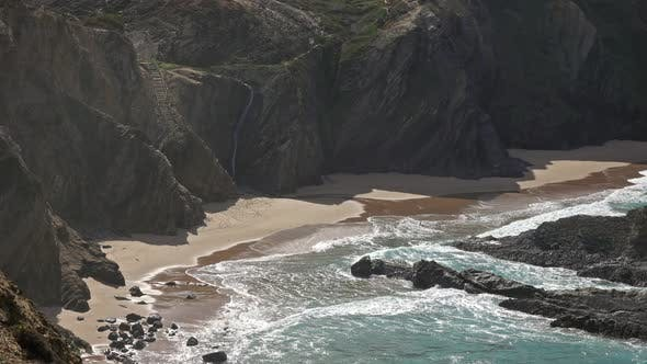 Cover Image for Sandy Beach and Cliff Rocks on Atlantic Coast