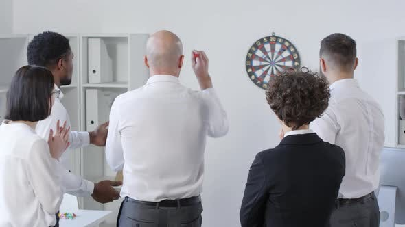 Thumbnail for Five Multiracial Colleagues Playing Darts Together
