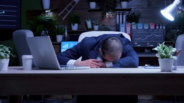 Overworked Businessman Fell Asleep at Night in the Office
