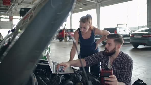 Thumbnail for Checking Car with Laptop