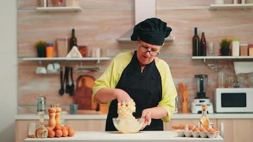 Old Lady Wearing Chef Bonete