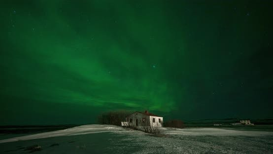 Thumbnail for Timelapse of Aurora Borealis Northern Lights Over Small Building in the Show Field. Iceland in the