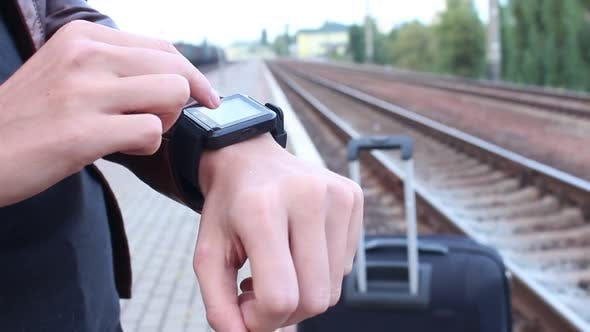 Thumbnail for Woman Using Smart Watches At The Station