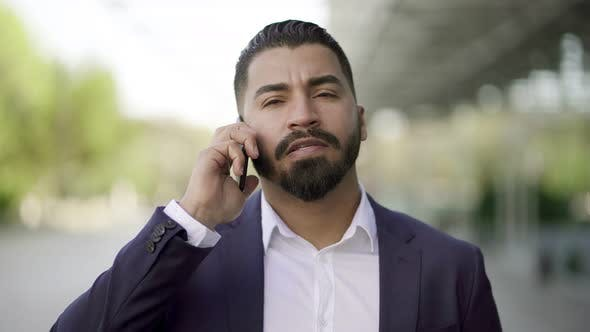 Thumbnail for Serious Businessman Talking By Mobile Phone Outdoor
