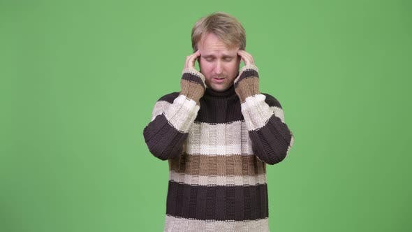 Cover Image for Studio Shot of Stressed Man Having Headache