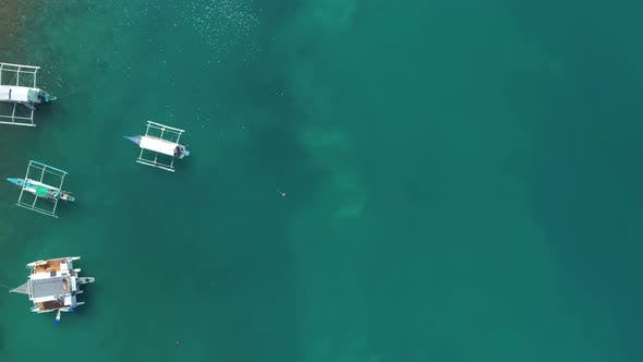Thumbnail for Top Drone View of a Traditional Philippine Boats on the Surface of the Azure Water in the Lagoon