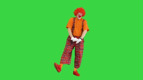 Male Clown Yawning Stitching and Doing Some Exercise in the Morning on a Green Screen Chroma Key