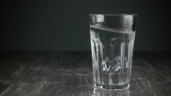 Thumbnail for Two Ice Cubes Fall Into a Glass of Water