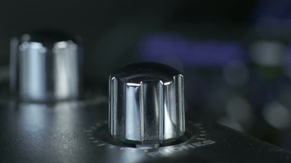 Thumbnail for Male Fingers Turning Silver Audio Interface Knob