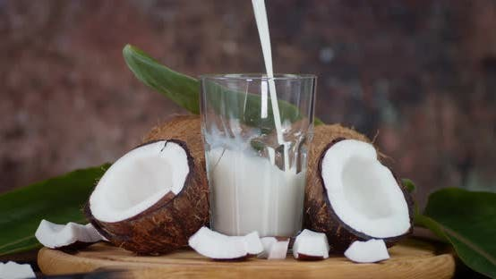 Coconut Juice Is Poured Into a Glass.