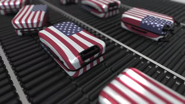 Thumbnail for Suitcases Featuring Flag of the USA Move on Roller Conveyor