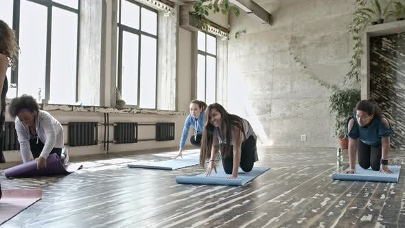 Thumbnail for Young Women Preparing for Yoga Class
