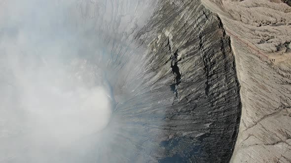 Smoke on Ijen volcano crater in East Java, Indonesia