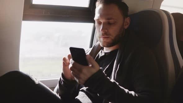 Thumbnail for Happy Relaxed European Freelance Worker Using Smartphone Messenger App