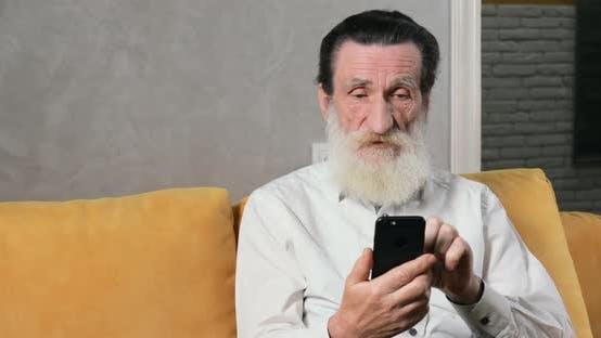 Thumbnail for Senior Citizen Uses Smartphone