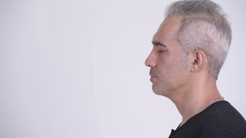 Profile View of Handsome Persian Man Against White Background