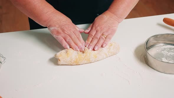 Thumbnail for Hands of Senior Bakery Kneading Dough