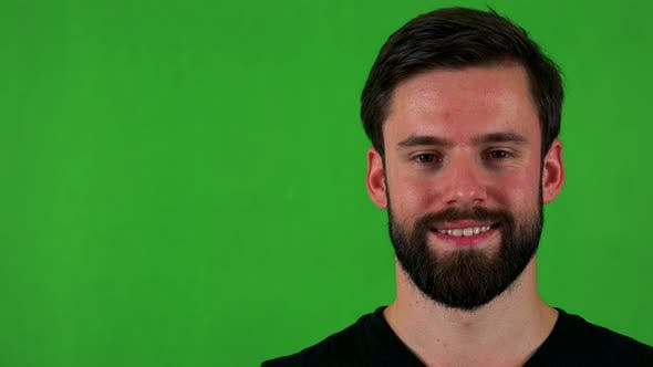 Thumbnail for Young Handsome Bearded Man Smiles To Camera - Green Screen - Studio - Closeup