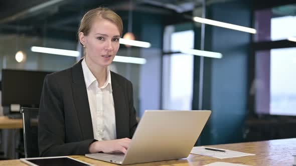 Thumbnail for Attractive Young Businesswoman Saying No By Finger in Office