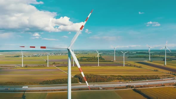 Cover Image for Aerial View of Wind Turbines Farm and Agricultural Fields. Austria.