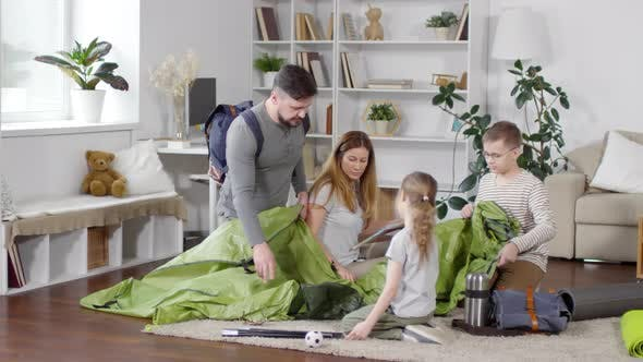 Thumbnail for Family Unpacking Tent in Apartment