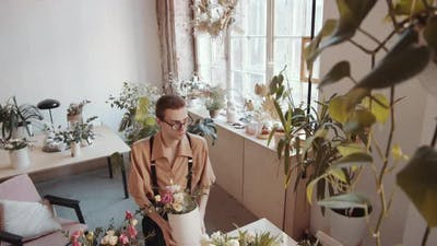 High Angle Shot of Male Florist Making Composition at Table in Flower Shop