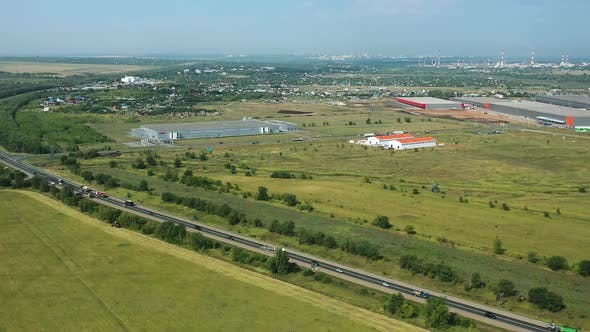 Thumbnail for Aerial View, Road Junction, Highway. Country Road, Production Facilities and Warehouses. Russia
