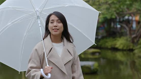 Cover Image for Woman bring of umbrella in the park
