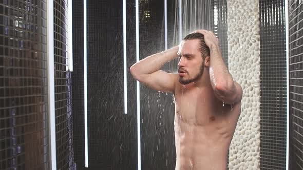 Nude Sexy Nice Man Under the Contrast Shower. Slow Motion