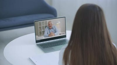 Distance Learning Online Education. A Woman Studies at Home and Elearning Zoom Video Call. A Home