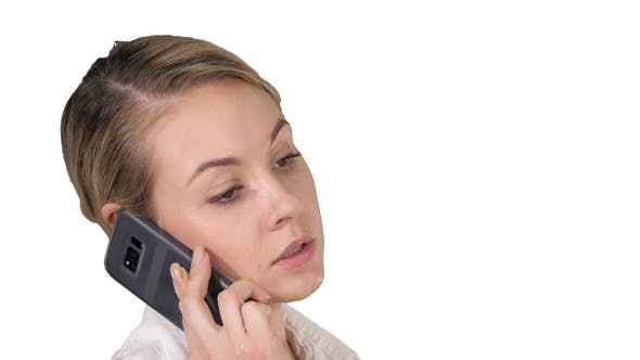 Cover Image for Woman with blonde hair talking on cellphone on white background.