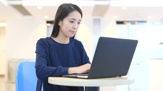 Thumbnail for Woman Doing Homework on Laptop Computer in Campus